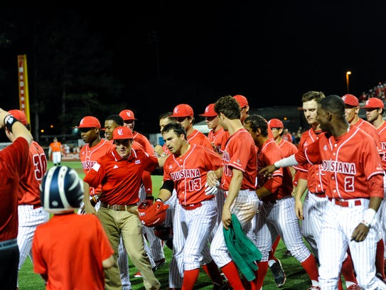 The Cajuns celebrate a home run by Brenn Conrad (13)