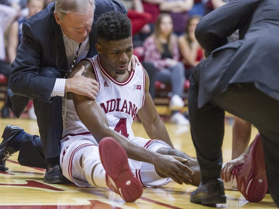 Indiana Hoosiers guard Robert Johnson (4) has the attention