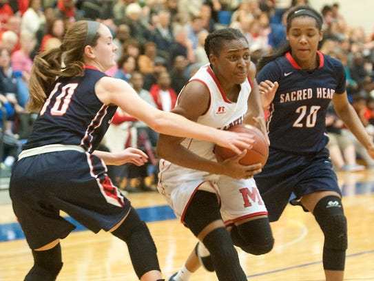 Jaela Johnson, center, during a game last season against Sacred Heart.