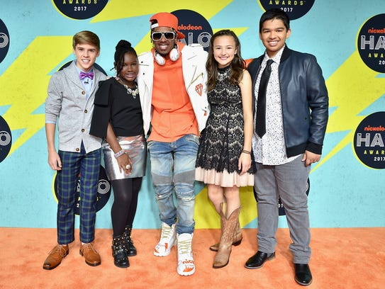 Rapper and actor Nick Cannon, center, poses with Nickelodeon