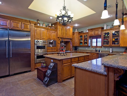 Majestic Cook's Kitchen with knotty Alder wood cabinetry,