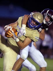 Brentwood's Parker Bullion is tackled as he makes a