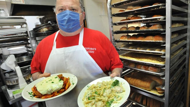 Gennaro's Eatery owner Gerry Martocchio serves up dinners at his Quincy restaurant, Saturday, Oct. 31, 2020. Tom Gorman/For The Patriot Ledger