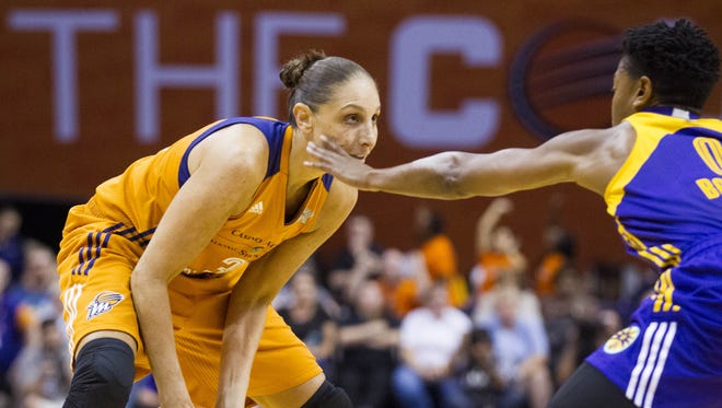 Mercury guard Diana Taurasi (3) looks to pass as Sparks guard/forward Alana Beard (0) defends in the first half at Talking Stick Resort Arena in Phoenix on Sunday, Aug. 28, 2016.