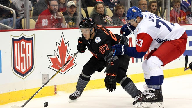 Sep 14, 2016; Pittsburgh, PA, USA; Team North America forward Connor McDavid (97) chases the puck against Team Czech Republic forward Dmitrij Jaskin (23) in a World Cup of Hockey pre-tournament game at CONSOL Energy Center. Mandatory Credit: Charles LeClaire-USA TODAY Sports
