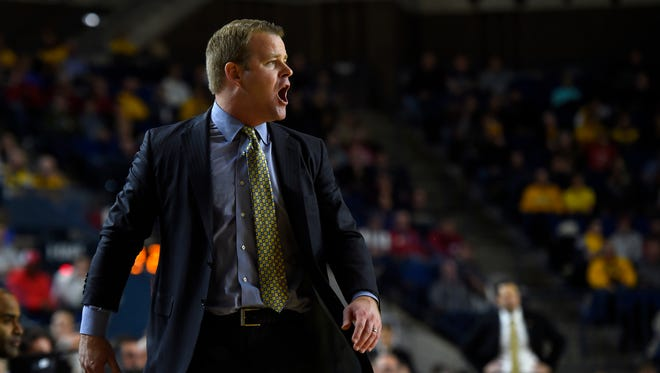 Marquette Golden Eagles head coach Steve Wojciechowski calls out to his team from the sideline during the second half of the game against the Vanderbilt Commodores at Alumni Hall. Marquette defeated Vanderbilt, 95-71.
