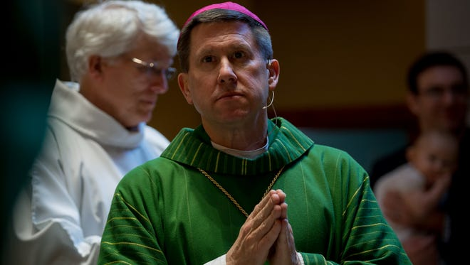 Bishop-elect Mark Spalding pauses while celebrating his final mass at Holy Trinity Catholic Church in Louisville, Ky., Sunday Jan. 14, 2018. Spalding is leaving Louisville to become Bishop in the Diocese of Nashville.