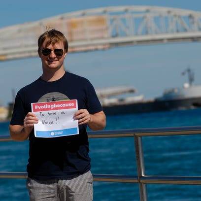 Mason May, of California, holds his #VotingBecause