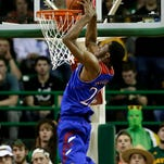 Kansas guard Andrew Wiggins (22) goes up for a dunk against Baylor on Feb. 4 in Waco, Texas.
