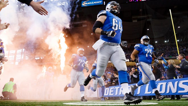 Detroit Lions offensive linemen take the field before a game against the Philadelphia Eagles at Ford Field in Detroit on Nov. 26, 2015.
