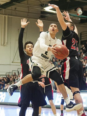 Rice's Kam Farris (2) leaps for a lay up during the boys high school semi final basketball game between the Rutland Raiders and the Rice Green Knights at Patrick Gym on Saturday afternoon February 27, 2016 in Burlington.