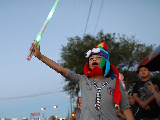 Gabi Mancha, 9, holds up a light sword as she watches the 2017 Buc Days parade.