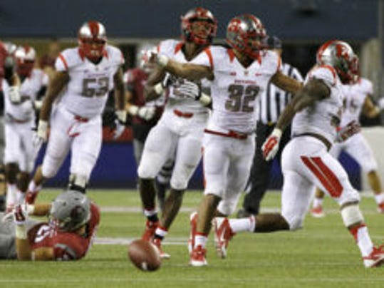 AP Former Madison star Justin Goodwin (32) will be returning to his natural position of halfback for the Scarlet Knights. Goodwin had spent time in the secondary. Rutgers defensive players Johnathan Aiken, right, Justin Goodwin (32) and Davon Jacobs, third from right, celebrate after Aiken knocked the ball out of the hands of Washington State wide receiver River Cracraft late in the second half of an NCAA college football game, Thursday, Aug. 28, 2014, in Seattle. Rutgers won 41-38. (AP Photo/Ted S. Warren)