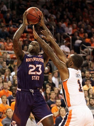Northwestern State Demons guard Zeek Woodley (23) takes a shot over Auburn Tigers guard Kareem Canty (1) during the first half at Auburn Arena.