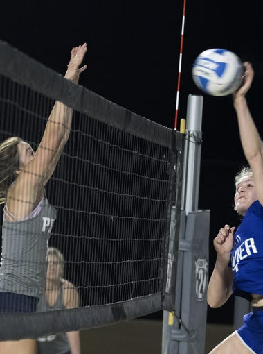 Xavier's Shannon Shields(right) powers one past Perry's  Erin Myers during the Division I Team Beach Volleyball State Championships against Fountain Hills at Casteel High School in Queen Creek, Arizona, May 02, 2019.