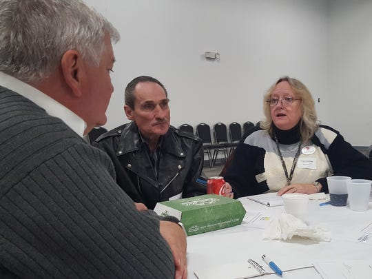 Jaclyn Ouellette (right) talks with Danny Amos (center) and the Rev. Matt Saarem during the Hunger and Homelessness Summit near Wausau on Dec. 12, 2016.