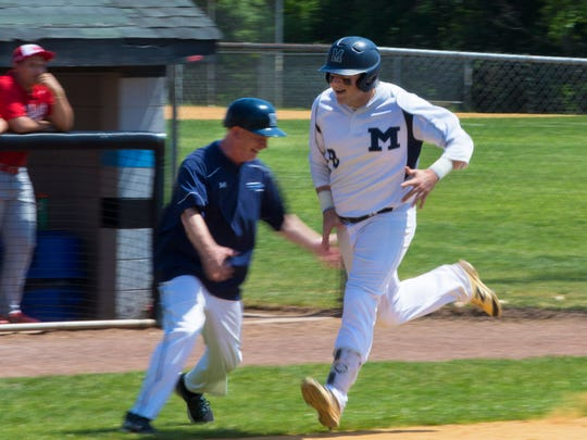 Manasquan's James Harmstead gets a hand shake from Coach Bob Waldeyer as he rounds the bases on s two run homerun.Manasquan vs Whipping Park in NJSIAA Group II Baseball Championship in Toms River, NJ on June 10, 2017.