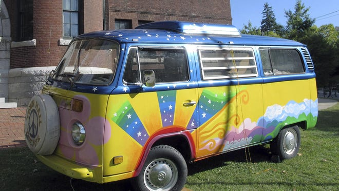 """In this Thursday, Sept. 22, 2016 photo, a vintage Volkswagen van sits outside the Vermont History Center in Barre, Vt., to promote """"Freaks, Radicals & Hippies,"""" a new exhibit about the state in the 1970s that opens there on Saturday after two years of research. (AP Photo/Lisa Rathke)"""