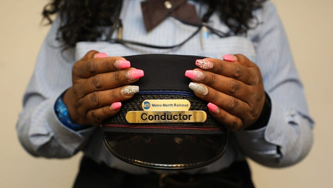 CeCee Grant-Briggs, a Metro-North conductor for 19 years, shows off her fingernails at a lounge at Grand Central Terminal, March 16, 2018.