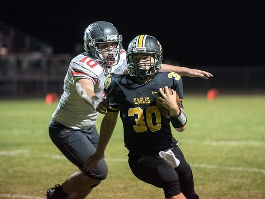 Colonel Crawford's Trevor Shawber avoids a tackle from