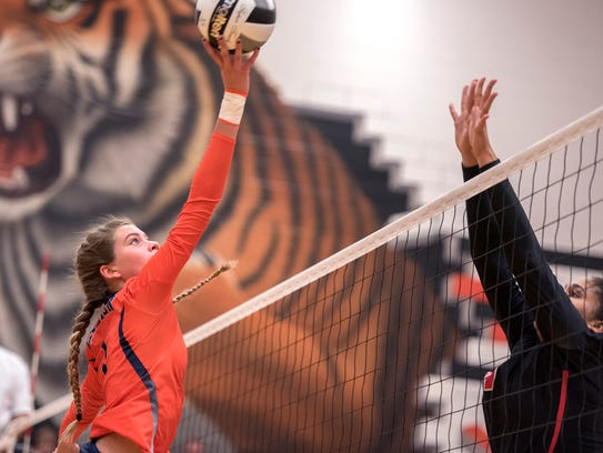 Galion's Samantha Comer attempts to hit the ball past