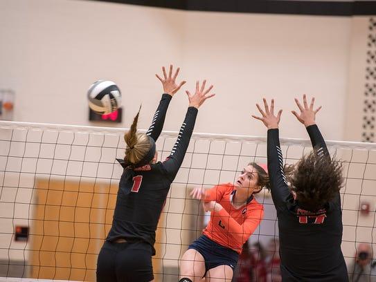 Galion's Marisa Gwinner spikes the ball past Crestview's