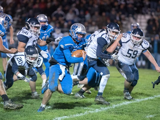 Wynford's Joel Griffin runs the ball for a first down.