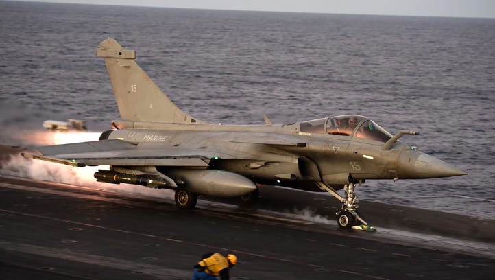 A Rafale fighter jet takes off from the deck of France's