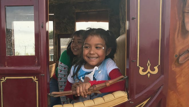 Children get a first-hand look at the inside of a stage coach during Christmas at Old Fort Concho in San Angelo Saturday, Dec. 2, 2017. The annual event draws attendees from all over with attractions that bring history to life at the preserved frontier outpost.