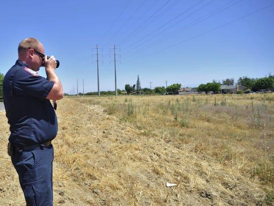 Visalia fire inspector Corbin Reed photographs overgrown