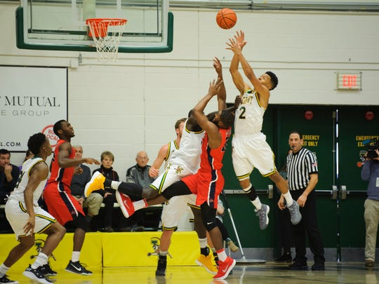 Vermont's Trae Bell-Haynes (2) leaps to grab the rebound during the men's basketball game between the Stony Brook Seawolves and the Vermont Catamounts at Patrick Gym on Saturday afternoon January 13, 2018 in Burlington.
