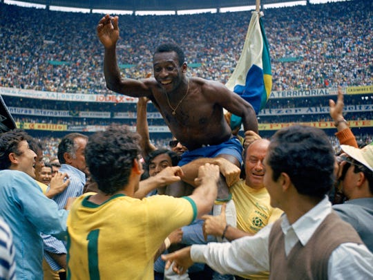 Brazil's Pele is hoisted on shoulders of his teammates after Brazil won the World Cup final against Italy, 4-1.