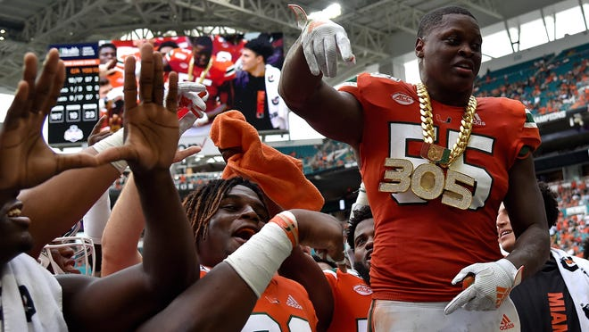 UM linebacker Shaquille Quarterman (55), wearing the turnover chain after recovering a fumble against Georgia Tech last season at Hard Rock Stadium, was the first Cane drafted (140th pick).