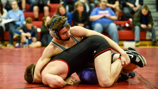 River Valley's Bryce Hessler ties up Pleasant's Brock Zugg at the MOAC Wrestling Championships earlier this year. Both advanced to Saturday's district meets.