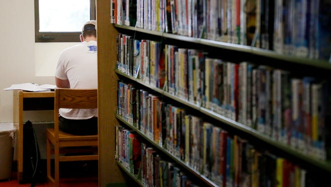A person reads inside the Steele Memorial Library in Elmira on June 7.