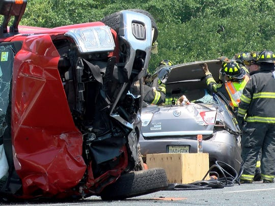 Toms River firefighters remove the roof of a sedan