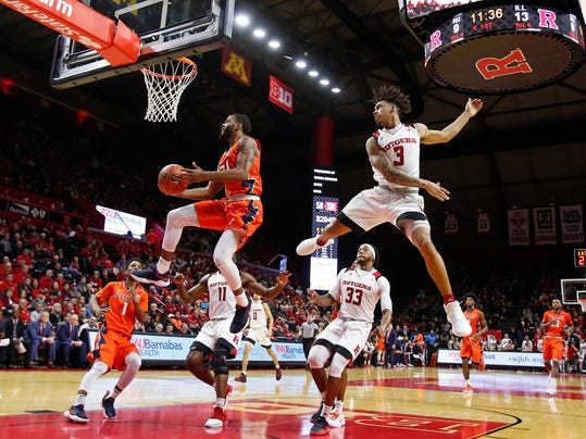 Illinois guard Mark Alstork (24) drives to the basket past Rutgers guard Corey Sanders (3) during the first half of an NCAA college basketball game Sunday, Feb. 25, 2018, in Piscataway, N.J. (AP Photo/Adam Hunger)