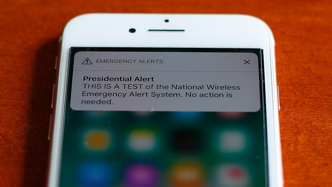 The first test of the national wireless emergency system by the Federal Emergency Management Agency is shown on a cellular phone in Detroit, Wednesday, Oct. 3, 2018. About 225 million electrtonic devices across the United States received alerts from FEMA Wednesday afternoon. (AP Photo/Paul Sancya) ORG XMIT: MIPS102