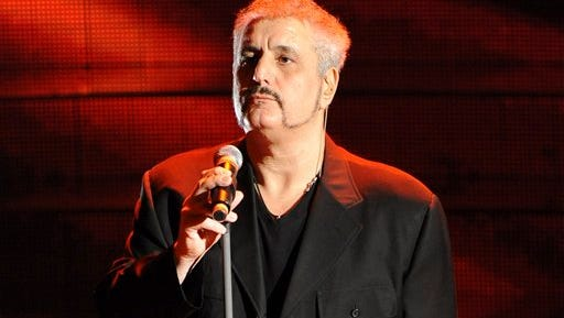 """In this file photo, Pino Daniele Performs during the """"Festival di Sanremo"""" Italian song contest, in San Remo, Italy. inger, songwriter and guitarist Pino Daniele, whose fusion of blues and jazz was greatly inspired by the beauty and ugliness of his native Naples, has died. He was 59.  Carlo Saitto, an official at Sant'Eugenio hospital in Rome, told Italian state TV that Daniele died Sunday night soon after arriving with grave cardiac and respiratory problems. Daniele, with a history of heart trouble, had given a New Year's concert in Italy last week. The musician was so identified with Naples that the city's mayor ordered flags flown at half-mast. Daniele's style was constantly evolving, as he experimented with blues and jazz. His voice, sexy, bordering on hoarse, was expressive, like his fellow Neapolitans. Some of his songs mixed Neapolitan dialect with Italian. He played with jazz stars like Wayne Shorter."""