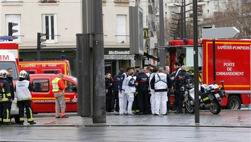 Emergency services workers arrive at a hostage-taking situation at a kosher market in Paris, Friday.