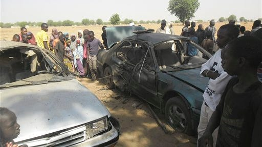 People gathered at the site of a suicide bomb attack at a car park of the College of Administrative and Business Studies in Potiskum Nigeria Friday, May 8, 2015. Suspected Boko Haram extremists attacked a business school in northeast Nigeria on Friday with gunfire and two bomb blasts. A suicide bomber died when he blew himself up prematurely in the car park of the College of Administrative and Business Studies in Potiskum, according to a security officer and a hospital worker.  (AP Photo/Adamu Adamu)