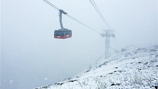 This Monday, July 27, 2015 photo provided by Jackson Hole Mountain Resort shows high-elevation snowfall during a cold front at Jackson Hole Mountain Resort in Teton County, Wyo. The middle of summer looked like the middle of winter in the mountains of western Wyoming. A cold front that moved through Monday afternoon dumped heavy rain on the valleys and snow above 9,000 feet.