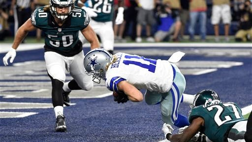 Eagles linebacker Kiko Alonso (50) watches as Malcolm Jenkins (27) is unable to stop Dallas Cowboys' Cole Beasley (11) from scoring a touchdown after making a catch in the first half Sunday.