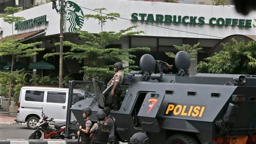 A police armored vehicle is parked outside a Starbucks cafe after an explosion in Jakarta, Indonesia Thursday, Jan. 14, 2016. Attackers set off explosions at a Starbucks cafe in a bustling shopping area in Indonesia's capital and waged gunbattles with police Thursday, leaving bodies in the streets as office workers watched in terror from high-rise buildings. (AP Photo/Achmad Ibrahim)
