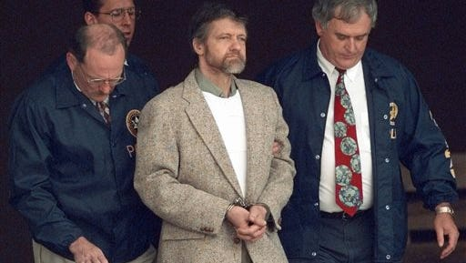 In this June 21, 1996, file photo, Theodore Kaczynski looks around as U.S. marshals prepare to take him down steps at the federal courthouse to a waiting vehicle in Helena, Mont. In handwritten letters to hundreds of supporters and curiosity seekers, Kaczynski expressed shock over the 9/11 attacks and wrote that he preferred Hillary Clinton over Barack Obama in the 2008 Democratic presidential race. Kaczynski also wrote to pen pals from federal prison in Colorado asking for more information about Osama bin Laden and the origins of al-Qaida, and has relied on others to inform him about the rise of the Internet and social media. (AP Photo/Elaine Thompson, File)
