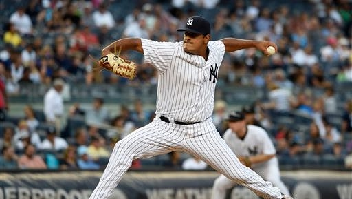 New York Yankees relief pitcher James Pazos throws against the Toronto Blue Jays in the ninth inning of a baseball game at Yankee Stadium, Sunday, Sept. 13, 2015, in New York. The Yankees won 5-0.
