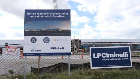 FILE - In this Oct. 17, 2015, file photo, construction work continues at the Riverbend high-tech manufacturing site in Buffalo, N.Y. The innovation hub is part of the Buffalo Billion investment, a plan to invest into the city of Buffalo. A federal investigation is examing whether Joseph Percoco and Todd Howe engaged in improper bidding for the Buffalo Billion project, as well as the Nano inititiave, a plan to attract nanotechnoogy jobs. (AP Photo/Mike Groll, File)