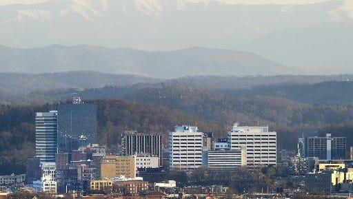 Snow-covered Thunderhead Mountain towers over Knoxville and the Tennessee Valley on Saturday, Feb. 13, 2016, as seen from Sharp's Ridge Memorial Park. At an elevation of 5,527 feet, Thunderhead is 4,641 feet higher than Knoxville.