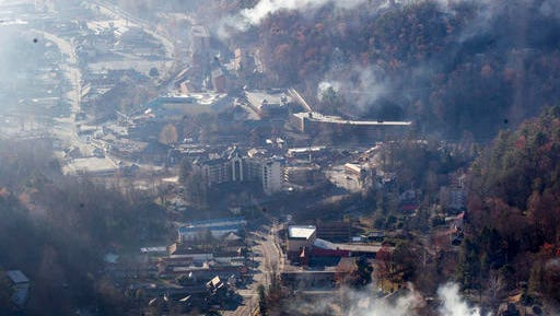 Burned structures are seen from aboard a National Guard helicopter near Gatlinburg, Tenn., Tuesday, Nov. 29, 2016. Thousands of people raced through a hell-like landscape to escape wildfires that killed several people and destroyed hundreds of homes in the Great Smoky Mountains.