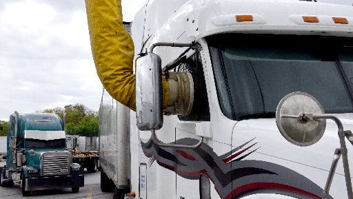 An IdleAir unit is hooked up to the cab of a truck at the T/A truck stop on Watt Road on April 16, 2015.